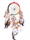 A red,green and black dreamcatcher isolated in white. — Photo