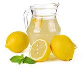 Lemon juice and fruit — Stock Photo