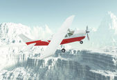Small private airplane in snow-capped mountains — Stock Photo