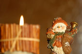 Christmas background, candle and funny snowman — Stock Photo