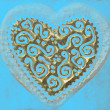 Love card, heart of gold on turquoise background — Stock Photo
