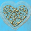 Love card, heart of gold on turquoise background — Stock Photo #6918459