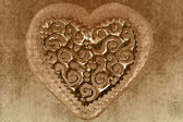 Vintage valentine card, sepia heart background — Stock Photo