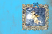 Christmas vintage cards, angel in an old painting on blue wall — Stock Photo