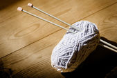 Ball of wool and knitting needles — Stock Photo