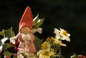 Christmas elf among winter flowers — Fotografia Stock