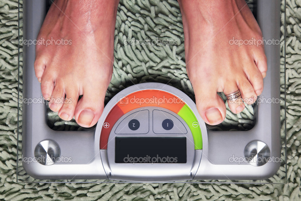Bathroom scales isolated against green carpet — Stock Photo #7226435