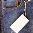 Blue jeans with blank tag — Stock Photo