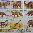 Stamp whit different images of dinosaurs — Stock Photo