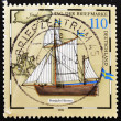 Stamp shows Postal sailing Ship - Stock Photo