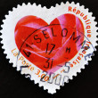 Royalty-Free Stock Photo: Stamp with the petals of a pink heart-shaped
