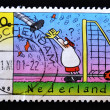 Stock Photo: Stamp showing soccer goalie cartoon