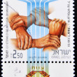 Stamp shows different hands clasped — Stock Photo #6904776