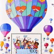 Stamp shows picture of children with cards and balloons - Stock Photo