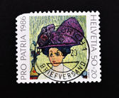 Stamp showing the painting of a woman wearing a hat made — Stock Photo
