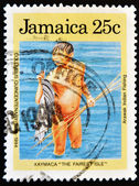 Stamp shows arawak indian fishing — Stock Photo