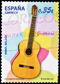 Stamp showing a spanish guitar — Stock Photo