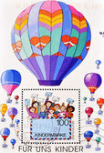 Stamp shows picture of children with cards and balloons — Stock Photo