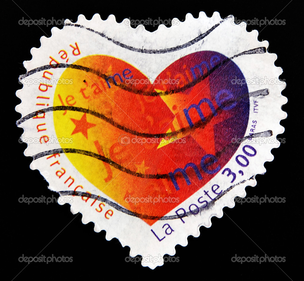 FRANCE - CIRCA 2003: A Heart Shaped Stamp with the word love you in French, circa 2003  — Stock Photo #6904596