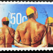 Постер, плакат: Stamp shows swimmers