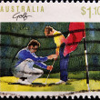 Royalty-Free Stock Photo: Stamp shows young boy being taught golf