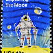 Stamp shows a man exploring the moon - Stock Photo