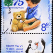 Royalty-Free Stock Photo: Stamp making health care a child with his teddy bear