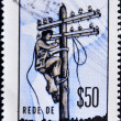 Royalty-Free Stock Photo: Stamp printed in Mozambique shows a man working in the telecommunications network