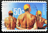Stamp shows swimmers — Stock Photo