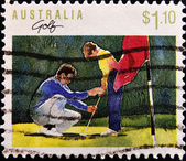 Stamp shows young boy being taught golf — Stock Photo