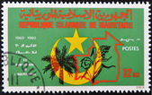 A stamp printed in Mauritania shows symbols of the country — Stock Photo