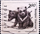 A stamp printed in Sweden shows two bears — Stock Photo