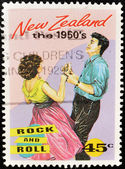 Stamp shows a couple dancing a rock and roll from the 50 — Stock fotografie