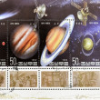 Foto Stock: Stamp shows different images of outer space with satellites and planets