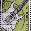 Stamp shows an electric guitar — Stock Photo #6993466