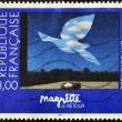Stamp shows the painting &quot;Le retour&quot; by Magritte - Stock Photo