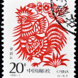 Royalty-Free Stock Photo: A stamp printed in China shows the drawing of a rooster