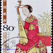 A stamp printed in china shows woman playing the lute — Stock Photo