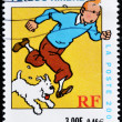 Stamp shows the cartoon character, Tintin and his dog Snowy - Stock Photo
