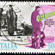 ITALY - CIRCA 1988: A stamp printed in Italy dedicated neorealist cinema shows a scene from the movie obsession of Luchino Visconti, circa 1988 - Stock Photo