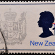 NEW ZEALAND - CIRCA 1970: A stamp printed in New Zealand, shows the New Zealand Coat of Arms and Queen Elizabeth II, circa 1970 — Stock Photo