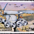 SHARJAH - CIRCA 1970: A stamp printed in Sharjah and dependencies shows spacecraft exploring the moon, circa 1970 — Foto de Stock