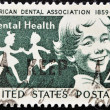 Stock Photo: Stamp shows smiling child in reference to dental health