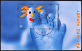 Stamp shows the foot of a child with a pattern in the finger — Stock Photo