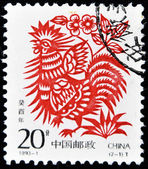 A stamp printed in China shows the drawing of a rooster — Stock Photo