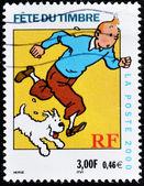 O selo mostra a personagem de desenho animado, tintin e seu cachorro nevado — Foto Stock