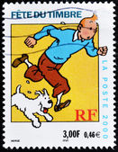 Stamp shows the cartoon character, Tintin and his dog Snowy — 图库照片