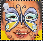 Stamp is dedicated to painted faces of children, butterfly — Stock Photo