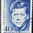 Stock Photo: GERMANY - CIRCA 1964. Vintage postage stamp printed in Germany shows a memorialized John F. Kennedy, circa 1964.