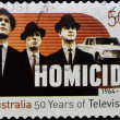 AUSTRALIA - CIRCA 2006: A stamp printed in Australia shows frame from the movie Homicide, circa 2006 - Stock Photo